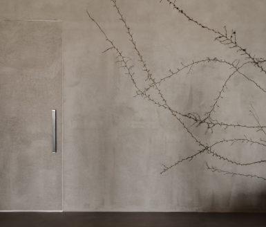 Inline vrata s prevleko iz cementne mase